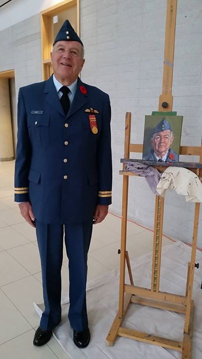 J. Al Watt of the Royal Canadian Air Force stands beside his portrait. #004/100 in the 100 Portraits/100 Poppies project. Guelph City Hall. July 7, 2015.