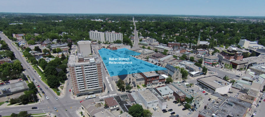 An aerial photo of Downtown Guelph highlighting the triangular shape of the Baker District redevelopment site bordered by Baker Street, Park Lane and Chapel Lane.