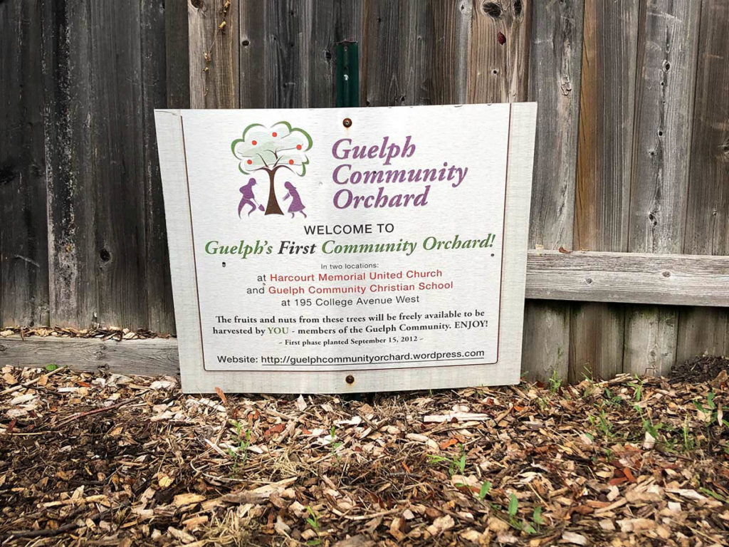 'Welcome to Guelph's First Community Orchard' sign