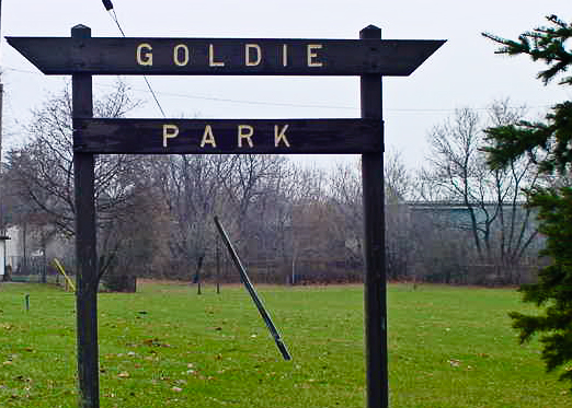 Wooden sign with the words Goldie Park